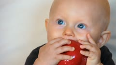 Boy with red apple Stock Footage