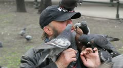 Man feeds pigeons with mouth Stock Footage