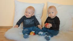 Twins boys with apples Stock Footage