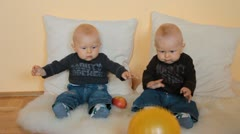Twins boys with ball Stock Footage
