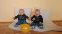 Twins boys with ball - stock footage