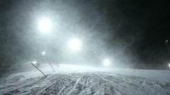Night snowstorm on the ski slope - stock footage