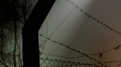 Barbed Wire Fence and Lights - stock footage