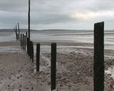 Poles on beach when tide is out Stock Footage
