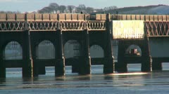 Ice floats beneath the Tay Rail Bridge. Scottish Countryside. Stock Footage