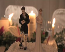 Wedding cake topper footballer groom Stock Footage