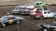 Demolition derby cars smashing into each other Stock Footage