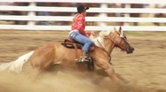 Stock Video Footage of Cowgirl Barrel Racing 1