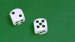 Dice two and five on green - stock footage