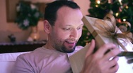 Stock Video Footage of Amazed man looking at something magical in gift box HD