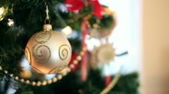 Golden christmas ball on tree, close up HD Stock Footage