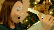 Stock Video Footage of Amazed woman looking at magical christmas gift in the box HD