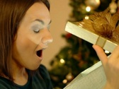 Stock Video Footage of Amazed woman looking at magical christmas gift in the box NTSC