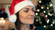 Stock Video Footage of Portrait of happy young woman in santa cap HD