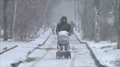 People in a snow storm Stock Footage