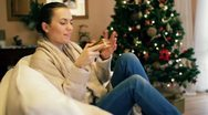 Stock Video Footage of Happy woman opening gift box, christmas tree in background HD