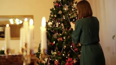 Woman decorating Christmas tree HD Stock Footage