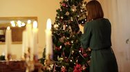 Stock Video Footage of Woman decorating Christmas tree HD