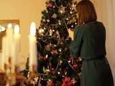 Stock Video Footage of Woman decorating Christmas tree NTSC