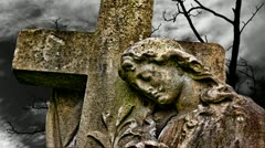 Timelapse clouds flowing past graveyard statue - stock footage