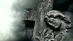 Timelapse clouds flowing past graveyard statue Stock Footage