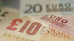 Pounds versus Euros - stock footage