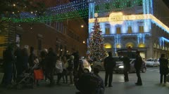 Glide around Christmas tree in Rome Stock Footage
