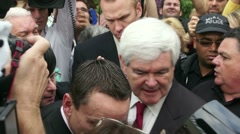 Newt Gingrich Exits To Car In Crowd Of Reporters Stock Footage