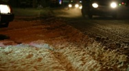 Slippery traffic on a snowy road at night Stock Footage
