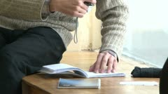 A student with a book at the table Stock Footage