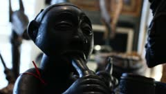 Dogon African Art Wood Carving Man with Flute Stock Footage