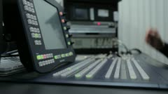 Person working on a Broadcast Switcher Stock Footage
