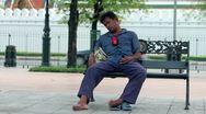 Homeless sleeps funnily Stock Footage