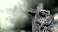 Stock Video Footage of Graveyard statue against stormy sky