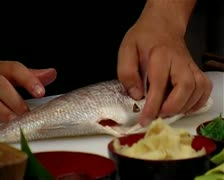 Chef Cleaning and slicing fish Stock Footage