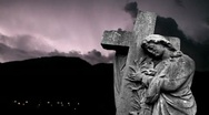 Stock Video Footage of Graveyard statue set against storm clouds with lightning strikes