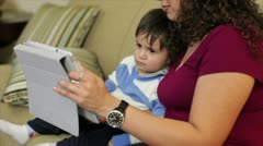 Hispanic mother and son using tablet Stock Footage