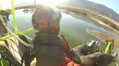 Pilot ultralight aircraft circle over frozen lake P HD 034-2 Stock Footage