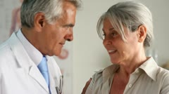 Senior doctor visiting a patient; Full HD Photo JPEG Stock Footage