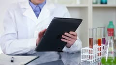 Female scientist hands working on tablet computer in laboratory HD Stock Footage