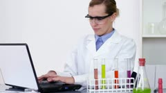 Female scientist working on laptop in laboratory HD Stock Footage