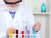 Female scientist working with test tubes with chemicals in laboratory NTSC Stock Footage