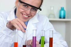 Portrait of young happy female scientist in laboratory NTSC - stock footage