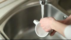Washing up tableware - stock footage