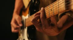 playing old electrical guitar in black - stock footage