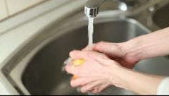 Hands washing orange Stock Footage