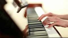 Playing piano Stock Footage