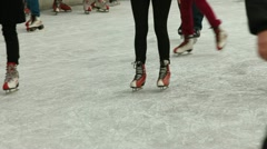 Feet of a crowd of ice skaters Stock Footage