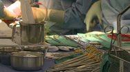 Nurse organizes surgical instruments Stock Footage