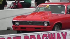 DRAGRACING-082 RED CHEVELLE SS POPPING A WHEELIE Stock Footage